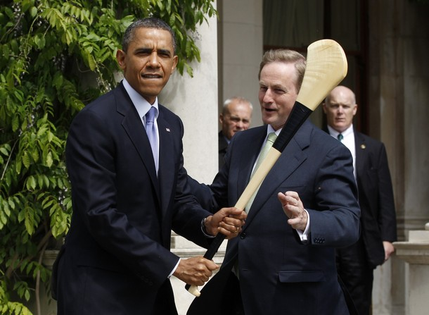 U.S. President Barack Obama jokingly swings a hurling stick given to him by Taoiseach Enda Kenny during his visit to Farmleigh House in Dublin