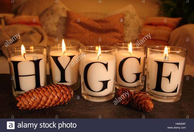 a-cosy-corner-in-an-english-living-room-lit-by-candles-that-depict-HMM28F