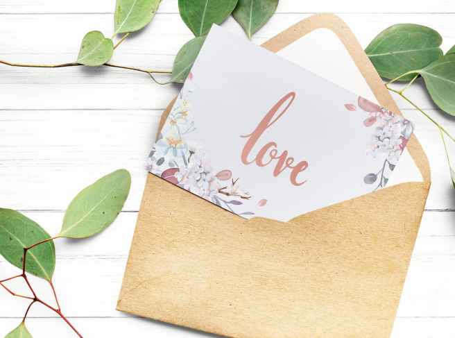 love text on white paper with brown envelope